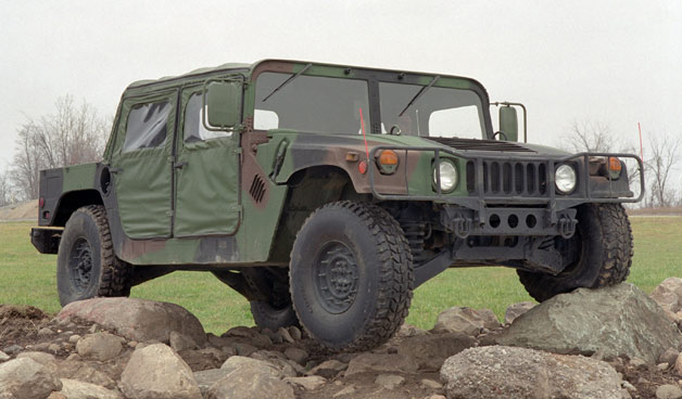 AM General Humvee in camo paint and on boulders