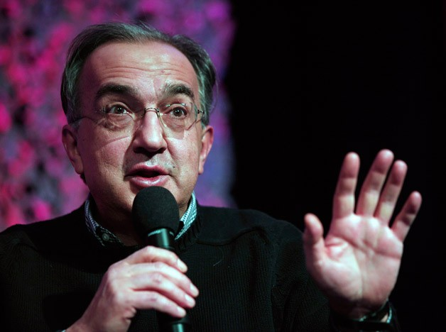 Fiat-Chrysler CEO Sergio Marchionne talks with microphone and his hand up