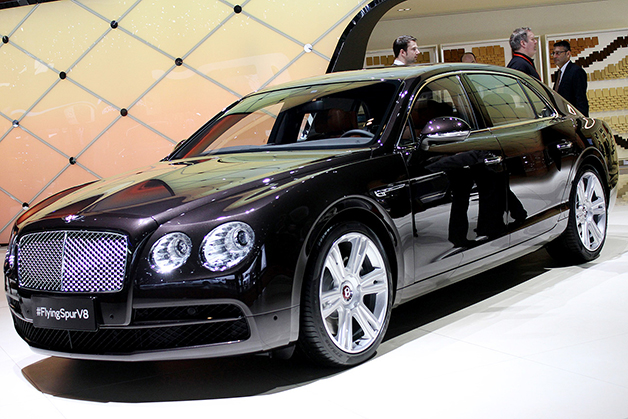 The Bentley Flying Spur V8 at the 2014 Geneva Motor Show, front three-quarter view