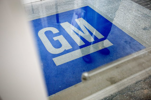 GM blue symbol on floor