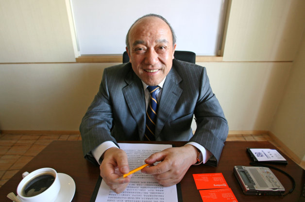 Wanxiang Qianchao Co. Ltd. Chairman Lu Guanqiu poses for a p