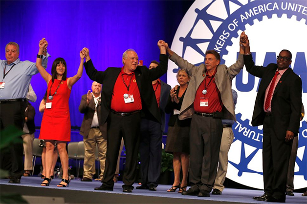 Dennis Williams (center) celebrates after being elected president of the UAW on June 4, 2014.