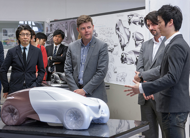 Andrew Smith, executive director of Buick global design, talks to students at the College for Creative Studies about their designs of a Buick concept for the year 2030.