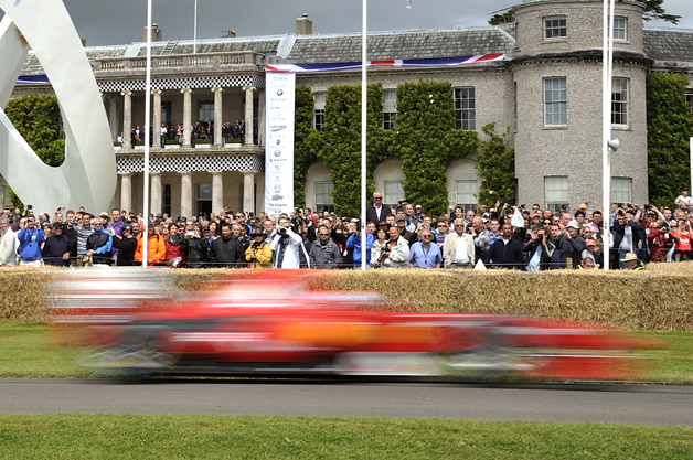 Ferrari F60 speeds past Goodwood House
