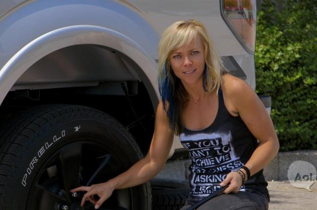 The List's Jessi Combs changes a flat tire