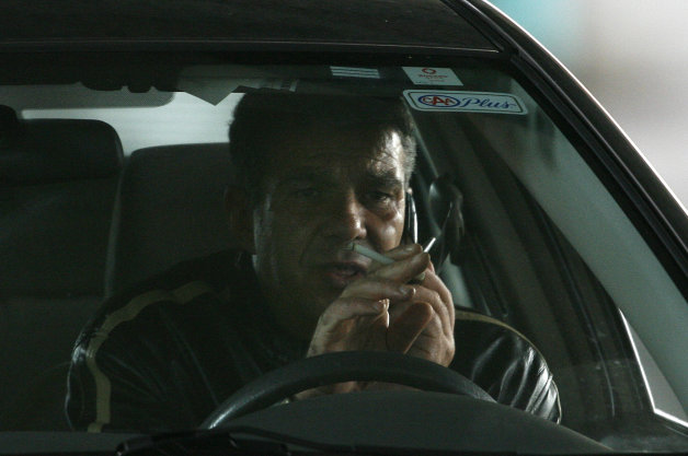 October 27, 2008 - A driver talks on his cell phone while smoking a cigarette and driving eastbound